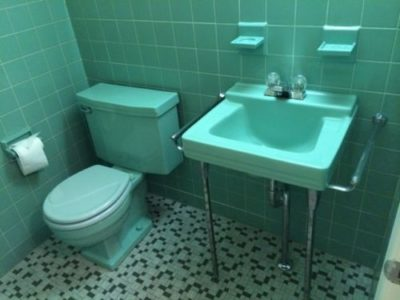 Aqua green toilet with sink