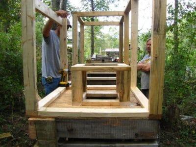 Carpenters building compost toilet