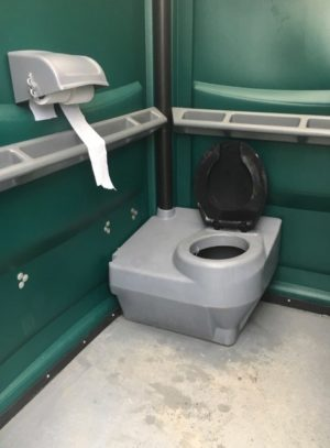 Inside picture of portable comfort room with toilet paper