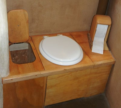Compost toilet with toilet paper holder
