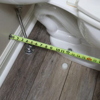 Tape measure measuring the width from the wall